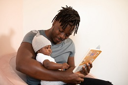 dad and infant reading