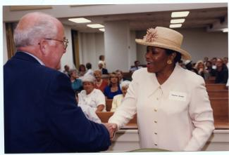 Senator Thelma Harper shaking hands with another politician
